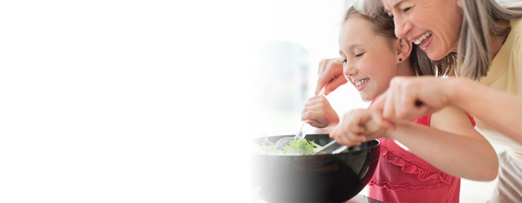 Mother & Daughter mixing a salad